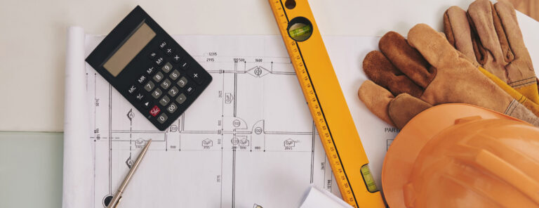 Blueprint, level and belongings of construction engineer